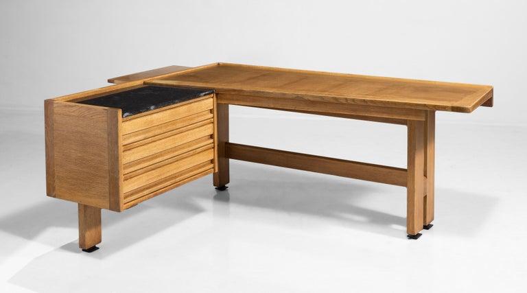 "Beautiful oak ""corner desk"" with black granite top over three-drawer storage compartment.    Guillerme et Chambron desk Measures: 74.5"" W x 59.5"" D x 30"" H."
