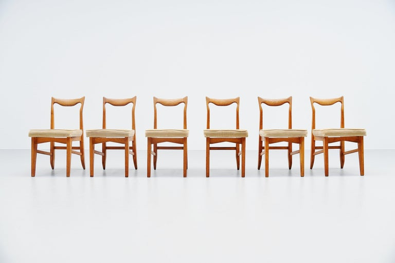 Set of 6 dining chairs designed by designer duo Robert Guillerme and Jacques Chambron, France 1950. The pieces were made in their own workshop and they made furniture from the 1950s to the 1970s. Mainly in solid oak and differently upholstery