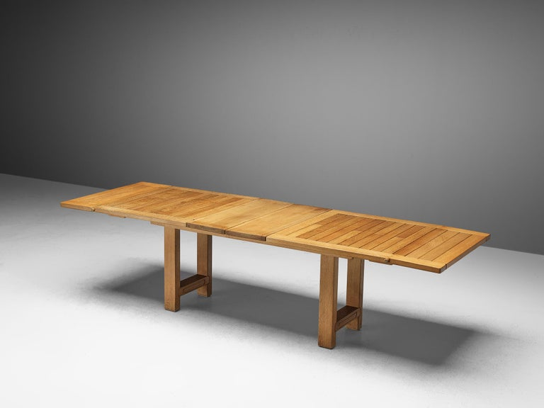 Guillerme et Chambron, dining table 'Bourbonnais', solid oak, France, 1960s  Extendable dining table by French designers Guillerme et Chambron. The table is versatile in the way that it may be extended with two leaves in the middle as well as two