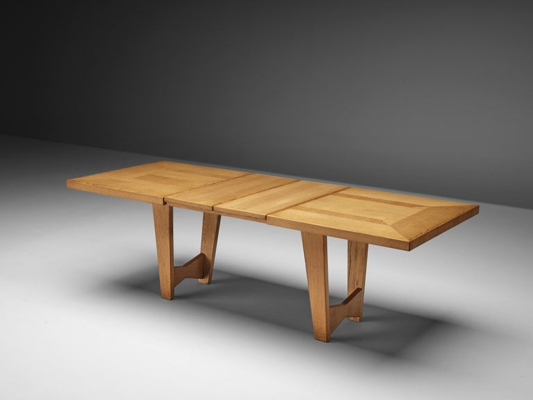 Guillerme et Chambron, dining table, oak, France, 1960s  Once again Guillerme et Chambron show their ability to combine great design with functionality. The rectangular tabletop can be extended with two extra leaves so the table is adjustable in
