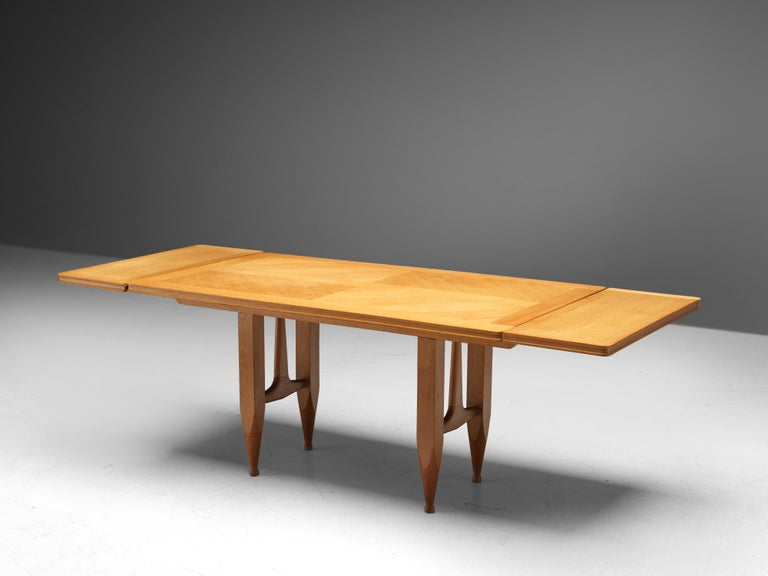 Guillerme et Chambron for Votre Maison, extendable dining table, oak, 1960s  Rectangular shaped dining table with inlayed top. This extendable table in solid oak comes with two optional leaves, which makes it a very versatile item. The sculptural