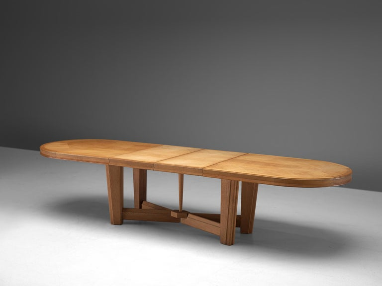 Guillerme et Chambron, extendable dining table, oak, 1960s.  Large oval shaped dining table with inlayed top. This extendable table in solid oak comes with two additional leafs, which add 1m/39inches and makes it a very versatile piece. The