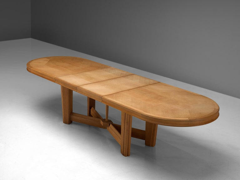 Mid-Century Modern Guillerme et Chambron Extendable Oval Dining Table in Oak For Sale