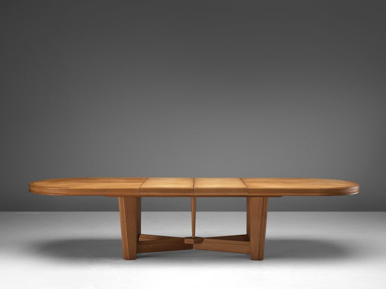 French Guillerme et Chambron Extendable Oval Dining Table in Oak For Sale