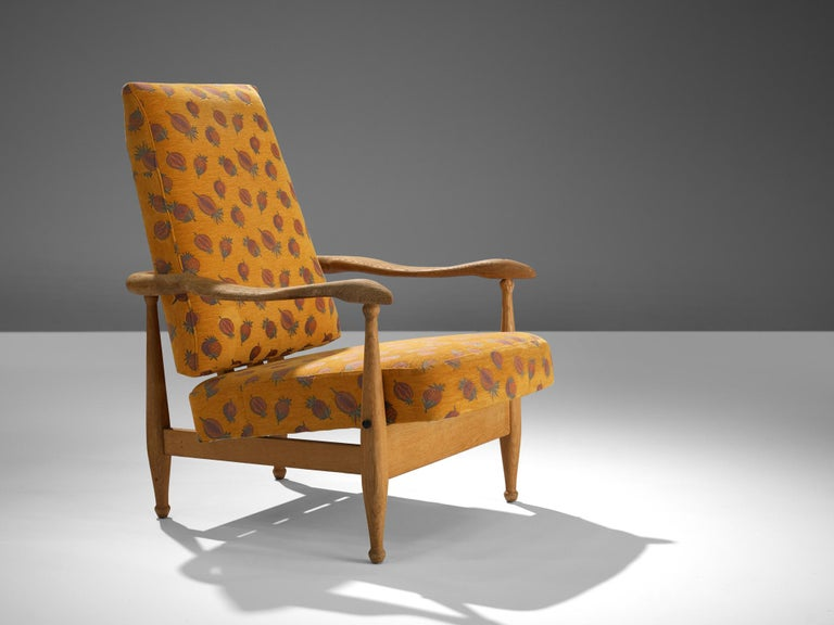 Guillerme et Chambron, lounge chair 'Dagobert'/'Air France', orange patterned upholstery, oak, France, 1960s.