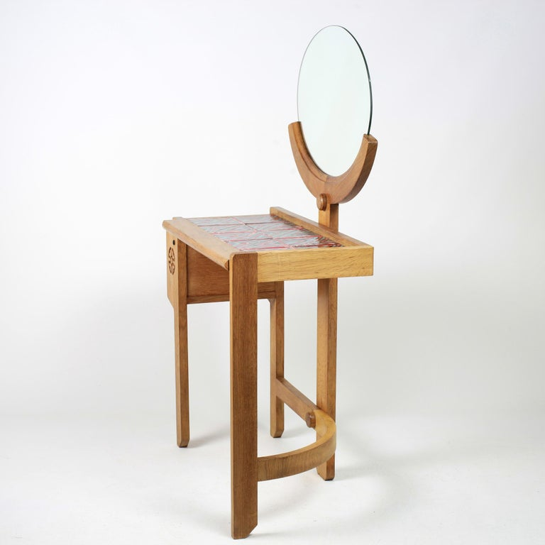 Solid oak vanity with mirror by Robert Guillerme and Jacques Chambron manufactured by Votre Maison. The ceramics on the top by Boleslaw Danikowski. Beautiful patina.