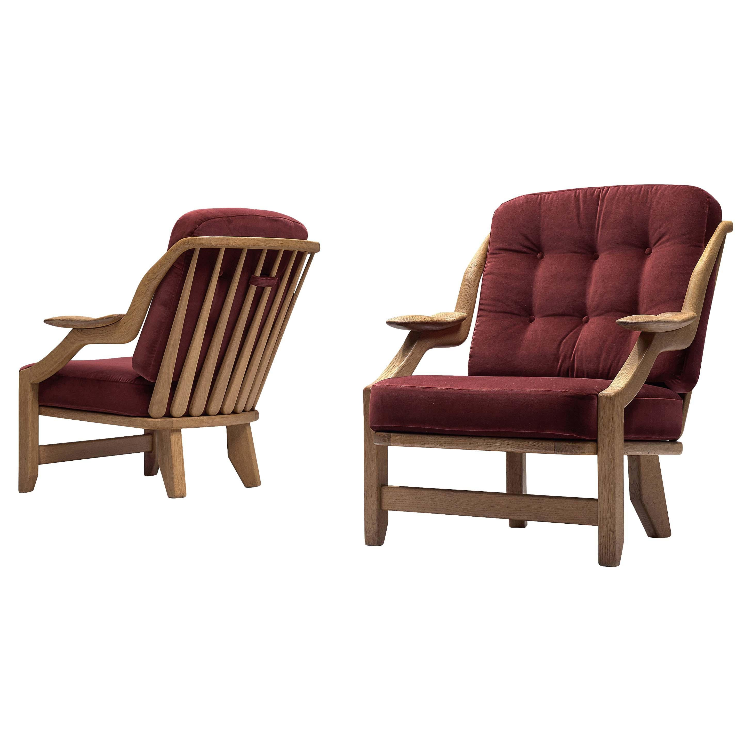 Guillerme et Chambron Pair of 'Gregoire' Lounge Chairs in Burgundy Upholstery