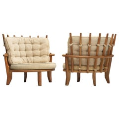 Guillerme et Chambron Pair of 'Tricoteuse' Lounge Chairs in Oak