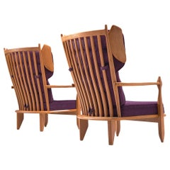 Guillerme et Chambron Pair of Wingback Lounge Chairs in Oak