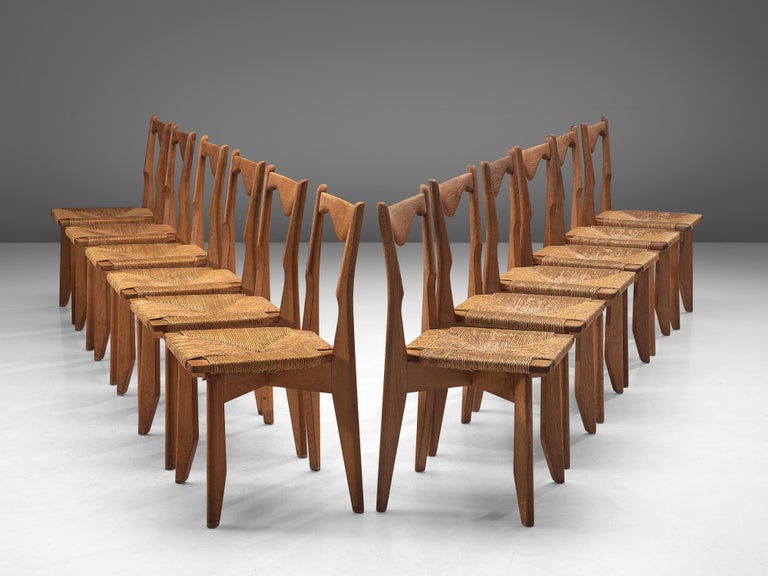Guillerme & Chambron for Votre Maison, set of 12 dining chairs, oak, straw, France, 1960s