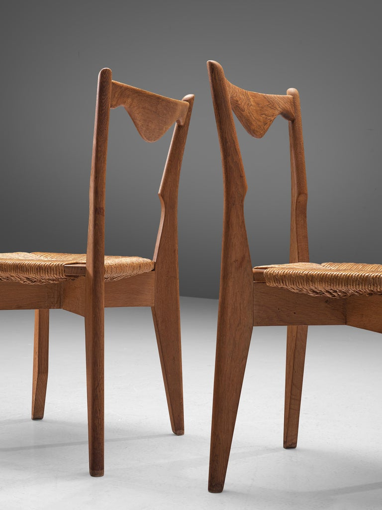 Mid-Century Modern Guillerme et Chambron Set of 12 Dining Chairs in Oak and Straw Seats For Sale