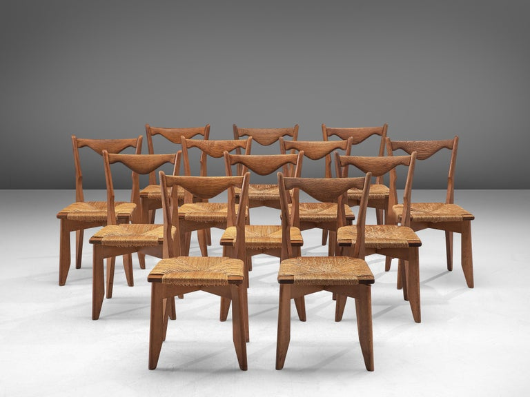 French Guillerme et Chambron Set of 12 Dining Chairs in Oak and Straw Seats For Sale