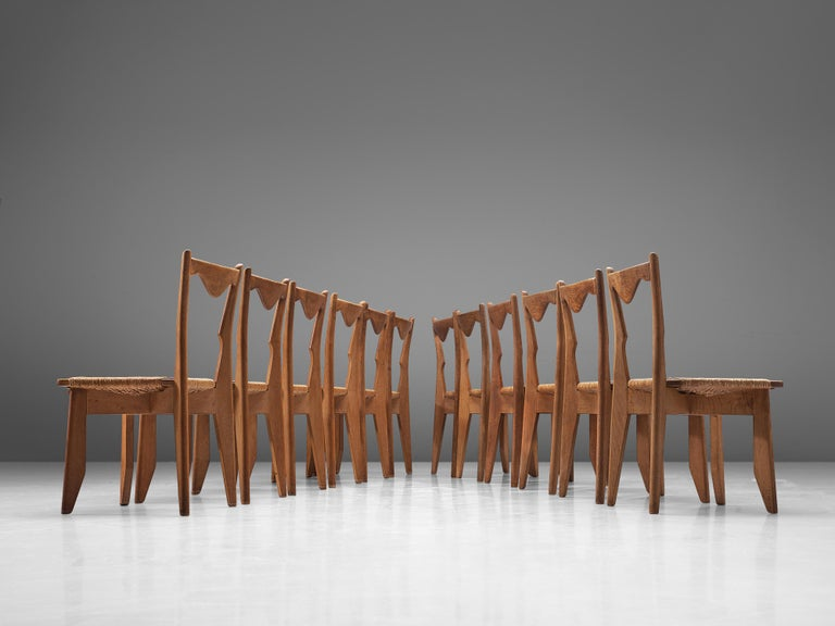 Mid-20th Century Guillerme et Chambron Set of 12 Dining Chairs in Oak and Straw Seats For Sale