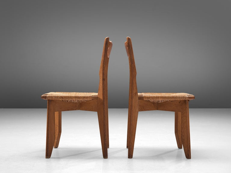 Guillerme et Chambron Set of 12 Dining Chairs in Oak and Straw Seats For Sale 3
