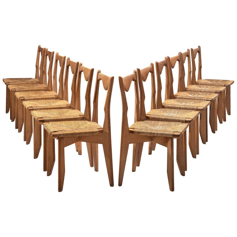 Guillerme et Chambron Set of 12 Dining Chairs in Oak and Straw Seats For Sale