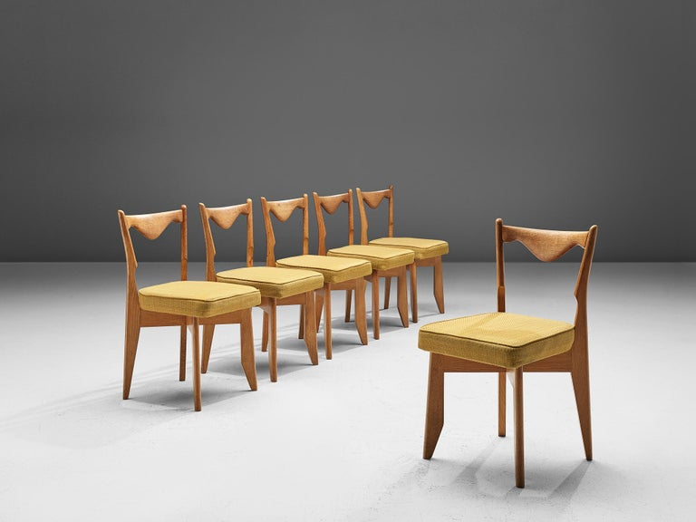 Jacques Chambron and Robert Guillerme, set of six dining chairs, solid oak and fabric upholstery, 1960s.