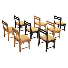 Guillerme et Chambron Set of Eight Bicolor Dining Chairs in Oak