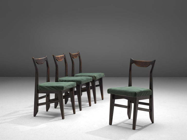Guillerme et Chambron, set of 4 dining chairs 'Marie Claire', darkened oak and fabric, France, 1960.
