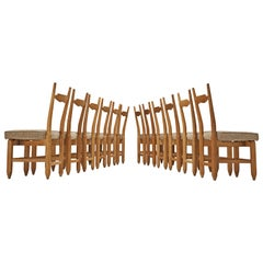 Guillerme et Chambron Set of Twelve Dining Chairs in Solid Oak
