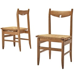 Guillerme et Chambron Set of Two Dining Chairs in Oak with Straw Seating