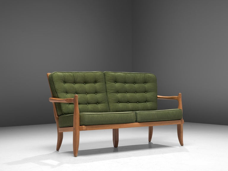 Guillerme et Chambron, sofa, oak and fabric, France, 1960s.