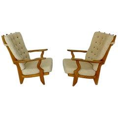 Guillerme et Chambron, Two Grand Repos Oak Armchairs Edition Votre Maison