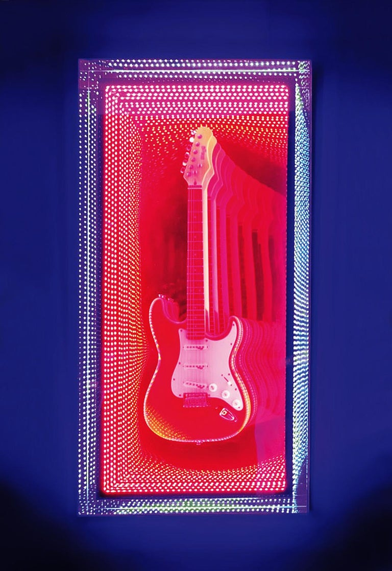 Wall decoration mirror guitar Infiny made with mirrored led lights with glass and plexiglass creating an infiny mirrored effect. With original and exceptional guitar style Fender Stratocaster. Exceptional piece made in France in 2019 by Raphael