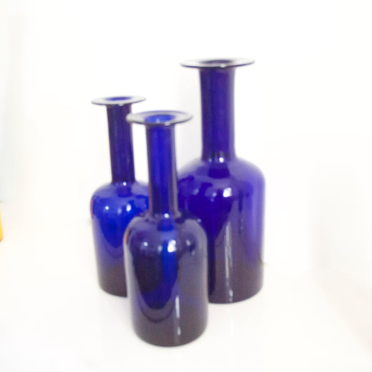 A three-piece pair of cobalt blue Gulvases by Otto Brauer based on a design by Per Lutken in 1958 for Holmegaard Kastrup  The larger vase is 30 cms in height the small 25 cms.
