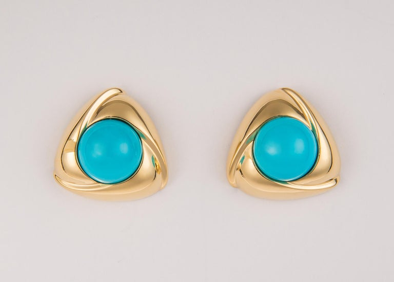 Gump's is famous for their high quality collectable treasures. This is a bold oversized design featuring vivid turquoise centers and rich 18k gold frames. Simply Chic !!!  1 1/8 inches in size.