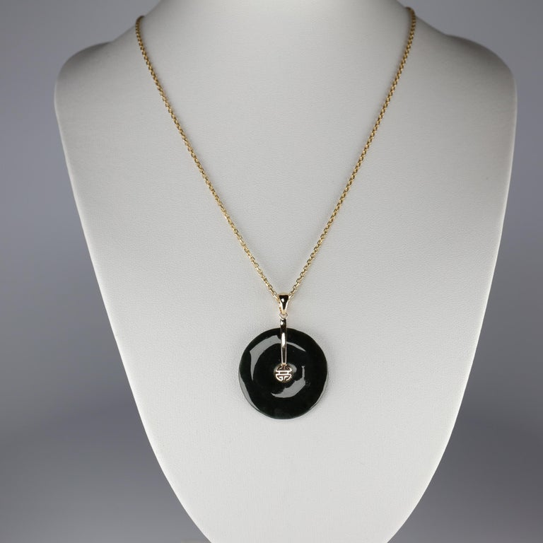 This vintage circa 1990s pendant was created by the iconic San Francisco retailer, Gump's; a name known worldwide for their supremely fine-quality 100% natural and untreated jade jewelry. This iconic pendant features a black jade (nephrite) pi disk