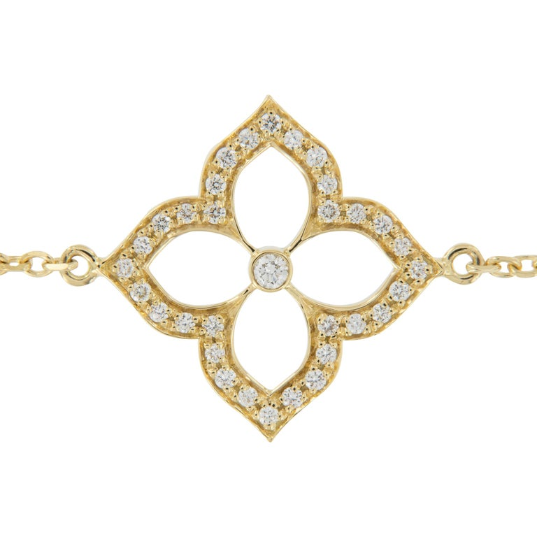 Versatile is what describes this reversible bracelet!  This lovely, 18 karat yellow gold Lotus bracelet was made in New York & can be worn with one side of the lotus flower being pave' set with diamonds or bright finished with one diamond in center