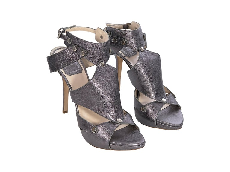 Product details: Gunmetal leather heels by Christian Dior. Ankle-buckle strap closures. Open-toe. Silver-tone hardware. Style yours with a sleeveless mini dress. 5