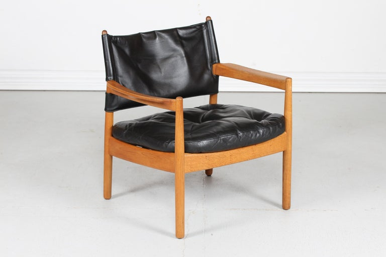 Easy chair by the Swedish furniture designer and architect Gunnar Myrstrand (1925-1997) manufactured by Källemo Sweden.  This chair is made of solid oak and upholstered with black leather  Nice vintage condition with good patina after normal