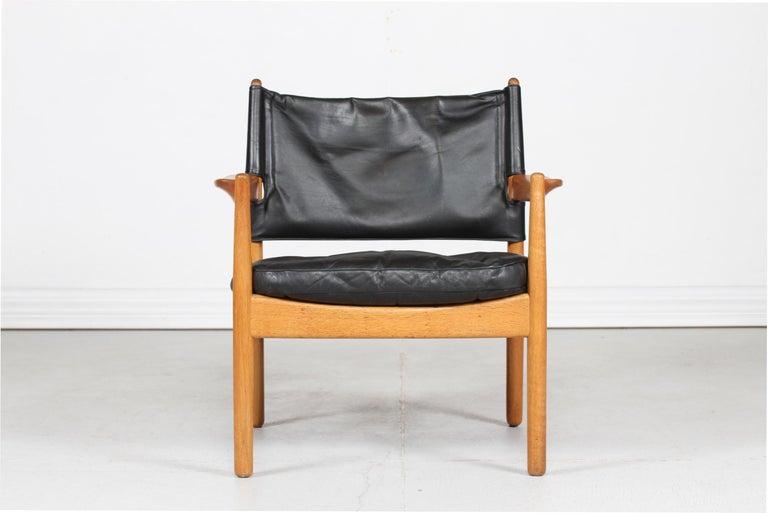 Scandinavian Modern Gunnar Myrstrand Easy Chair of Oak and Black Leather by Källemo, Sweden