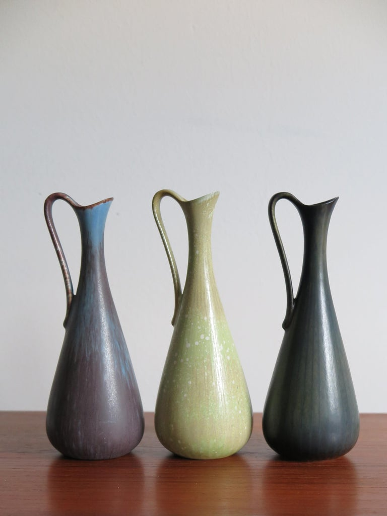 Set of three Scandinavian rare stoneware vases in matt enamel designed by Gunnar Nylund for Rörstrand, made in Sweden, marked on the bottom. Perfect condition.