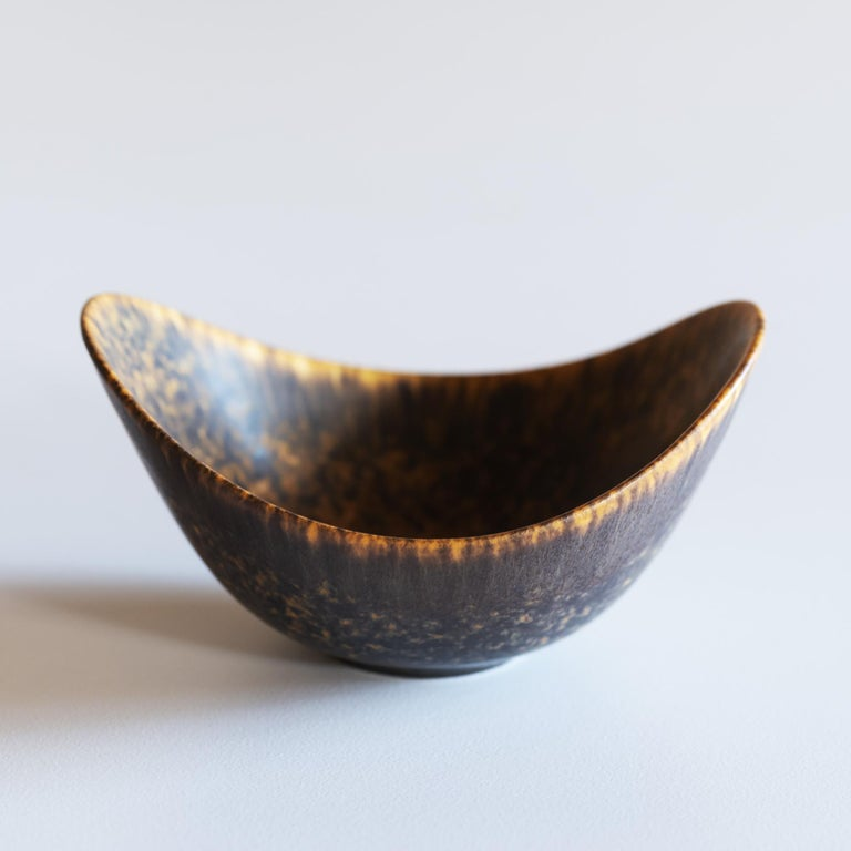 Single Gunnar Nylund stoneware vessel for Rörstrand, Sweden. Matte hares fur glaze in brown and black tones with golden accents.