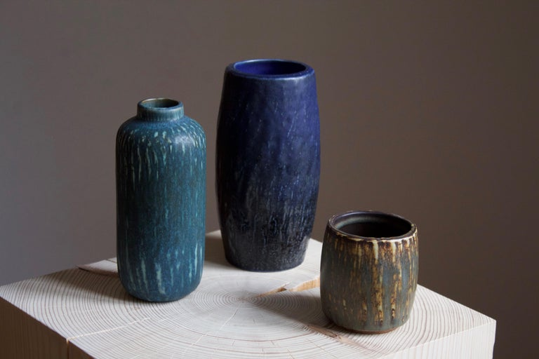 A set of three vases or vessels produced by Rörstrand, Sweden, 1950s. Designed by Gunnar Nylund, (Swedish, 1914-1997). Signed.