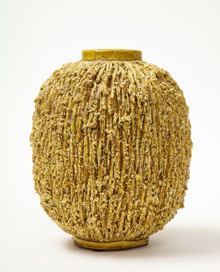 A yellow Chamotte vase by Swedish designer Gunnar Nylund. Produced at Rörstrand.