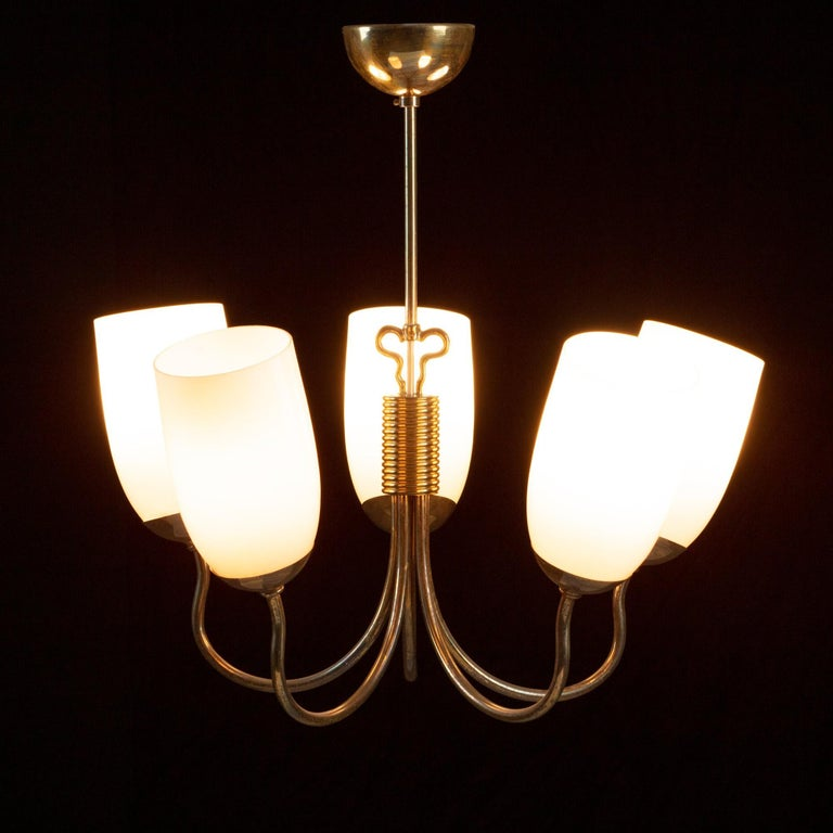 Gunnel Nyman Model 51118 pendant / chandelier for Idman, Finland, 1940s. Brass and five pinkish glass shades. A very nice example in great original condition.      UK customers please note: displayed prices do not include VAT.