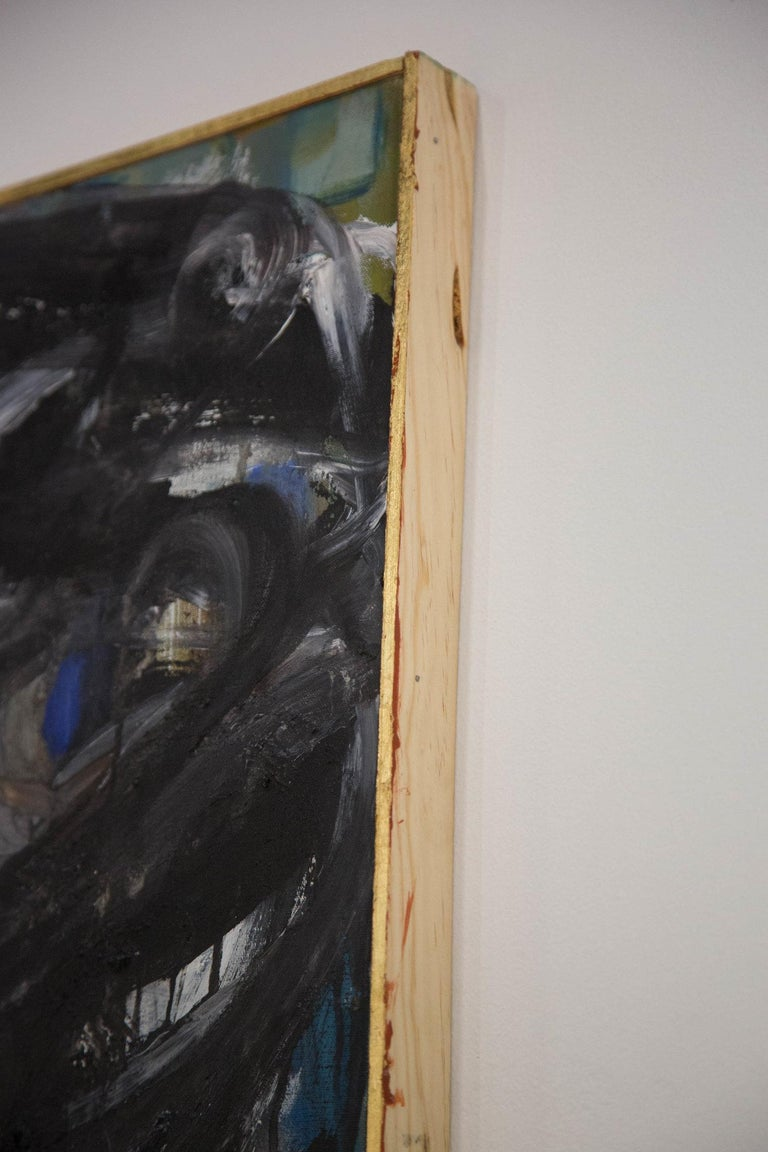 """An abstract expressionist painting featuring heavy impasto and energetic movement of black, white, washes of gray, cerulean and cobalt blue. Presented in a thin, gold wooden frame. Signed on the verso, """"GUR NY 1968""""  Dimensions:Framed 24.75"""