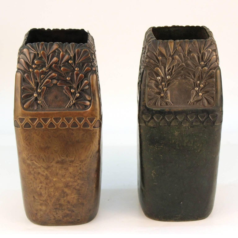 A pair of decorative vases in patinated bronze, made by celebrated Austrian sculptor and founding member of the Vienna Secession Gustav Gurschner (1873-1970). Marked 'Made in Austria, WKE [Wiener Kunst-Erzgiesserei] 504/111' on bottom, with One vase