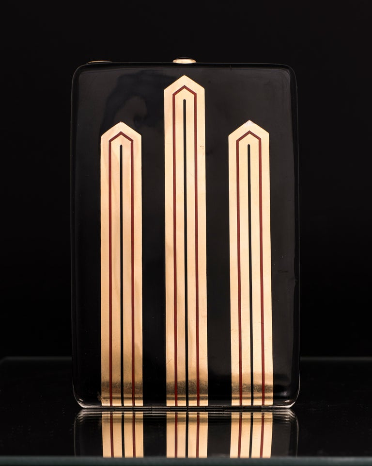 Express Shipping still available during Lockdown  Gustave-Roger Sandoz Cigarette Case, Circa 1925 Silver with Enamel geometric decoration on both sides. The clasp set with a cabochon of Onyx. With maker's mark and French assay marks Length : 5