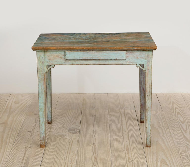 Swedish, Gustavian, 18th century table with a center drawer, circa 1790, origin Sweden  Table with beautiful, original paint and faux marble top. A wonderful desk / writing or side table.