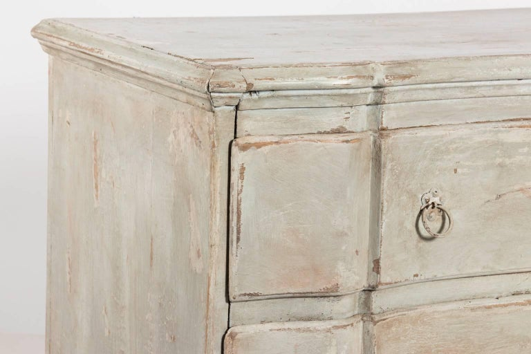 Mid-20th century vintage Gustavian style serpentine three drawer chest in a dove grey antiqued finish.