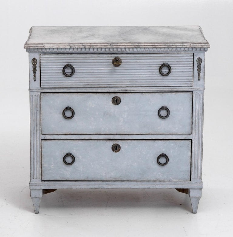 Gustavian style chest with carvings, faux painted marble top, 19th century.