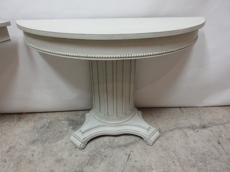 This is a set of 2 Gustavian style column console tables, they have been restored and repainted with milk paints