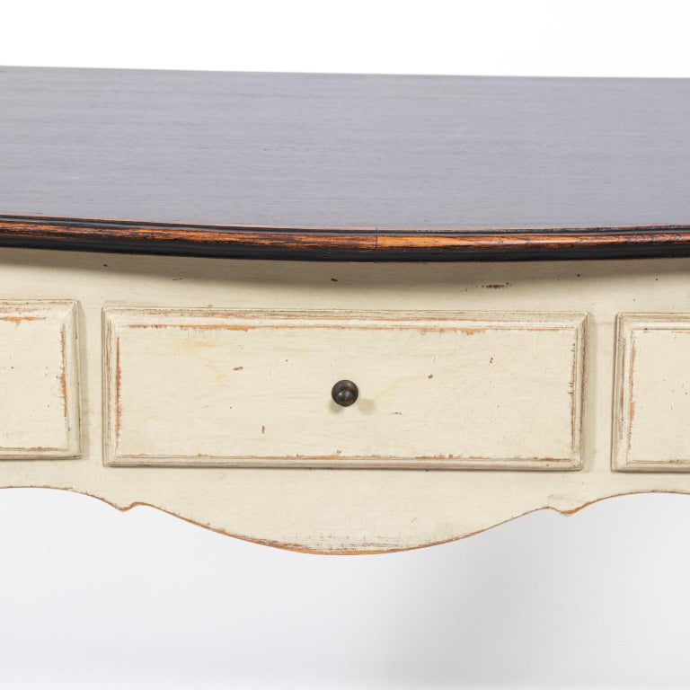 Gustavian style console table with three drawers and black painted top, circa 1970s. The piece also features cabriole legs and curved tabletop. Please note of wear consistent with age including wear and loss to the paint.