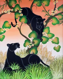 Black Panthers in a tree with a peach sky