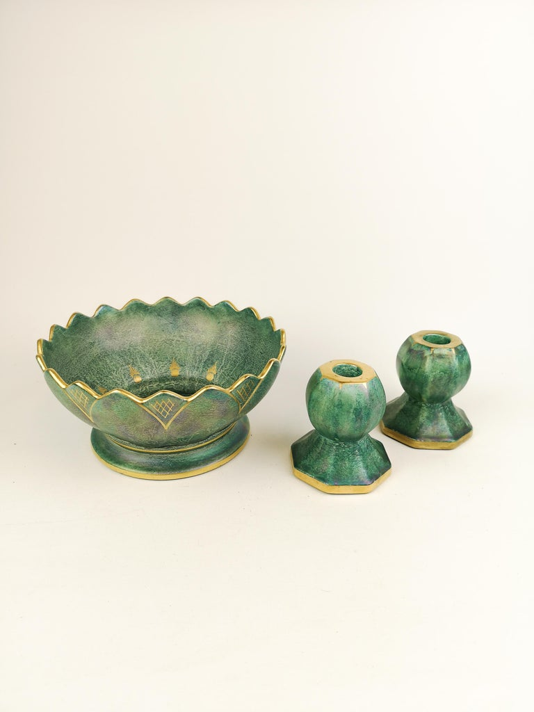 A wonderful bowl and candlesticks created by Josef Ekberg and manufactured by Gustavsberg Sweden in 1920s. Wonderful green glaze with hand painted gold pattern on the bowl and Candlesticks. 