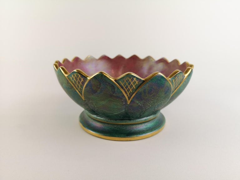 A wonderful bowl created by Josef Ekberg and manufactured by Gustavsberg Sweden in 1920s. Wonderful green glaze with hand painted gold pattern on the bowl.   Excellent condition.